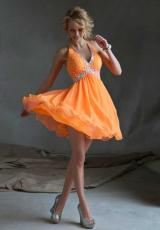 Mori Lee Sticks and Stones 9247.  Available in Neon Orange, Neon Pink