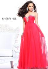 Sherri Hill 21097.  Available in Ivory, Pink, Watermelon, Yellow