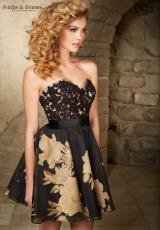 Mori Lee Sticks & Stones 9356.  Available in Black/Gold, Black/Red