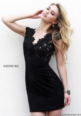 Sherri Hill Short 32006.  Available in Black/Nude, Red/Nude