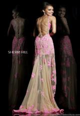 Sherri Hill 21161.  Available in Black/Nude, Coral/Nude, Ivory/Nude