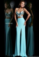 Sherri Hill 21332.  Available in Black/Silver, Coral/Silver, Fuchsia/Silver, Ivory/Silver, Light Blue/Silver, Nude/Silver, Orange/Silver, Purple/Silver, Red/Silver, Silver/Silver