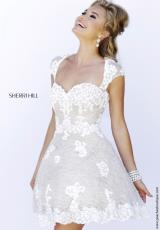 Sherri Hill Short 4331.  Available in Black/Nude, Ivory/Nude